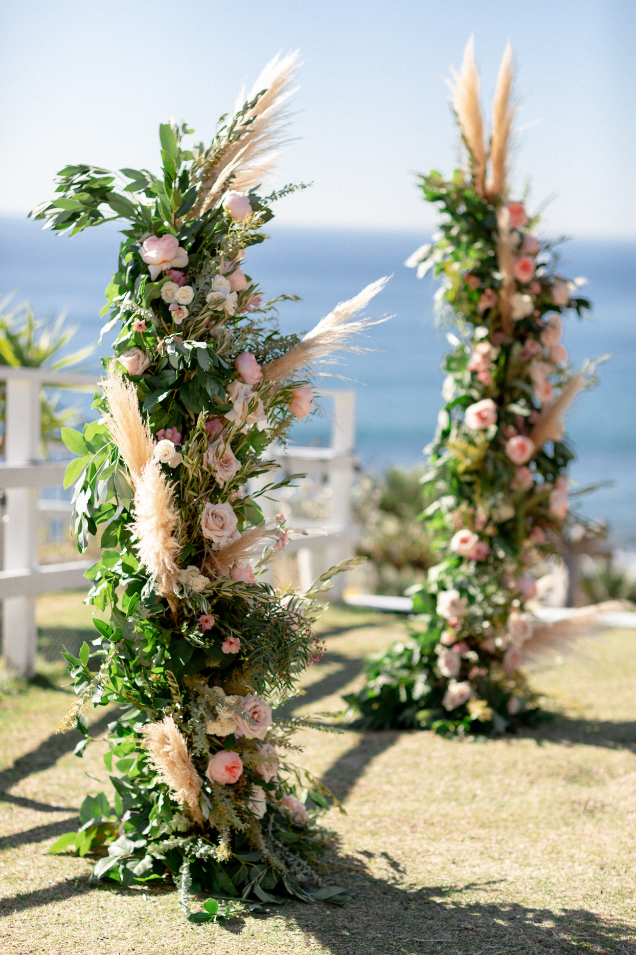 topless pink floral, pampas grass and greenery wedding arch