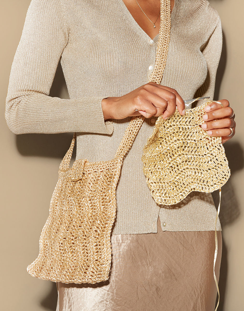 woman crocheting a handbag