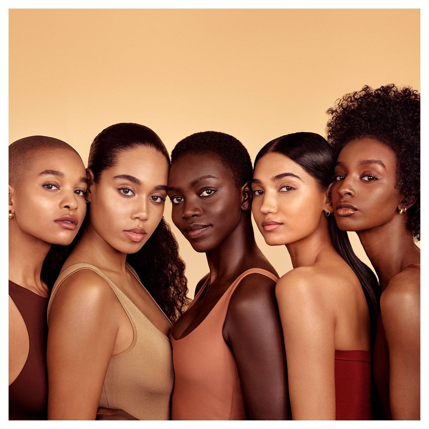 group of woman posing for skin care brand