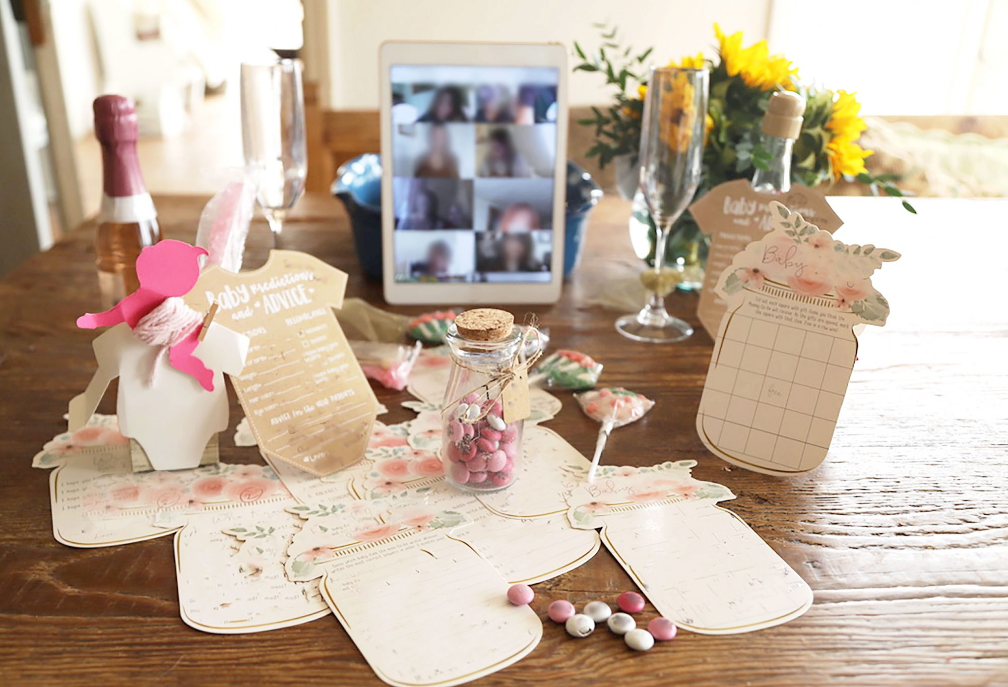 virtual baby shower setup on dining table