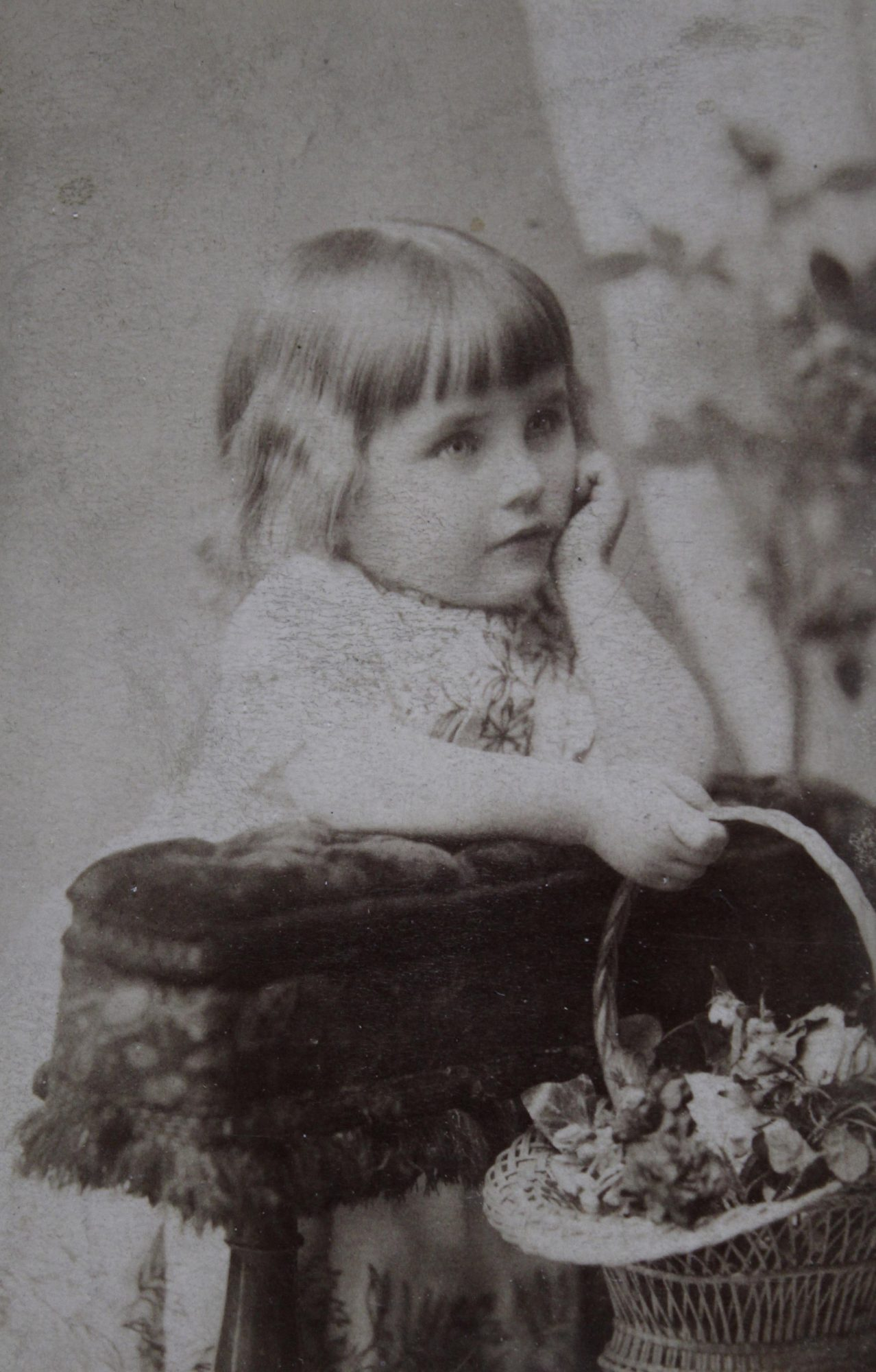 little girl from 1900s with easter basket