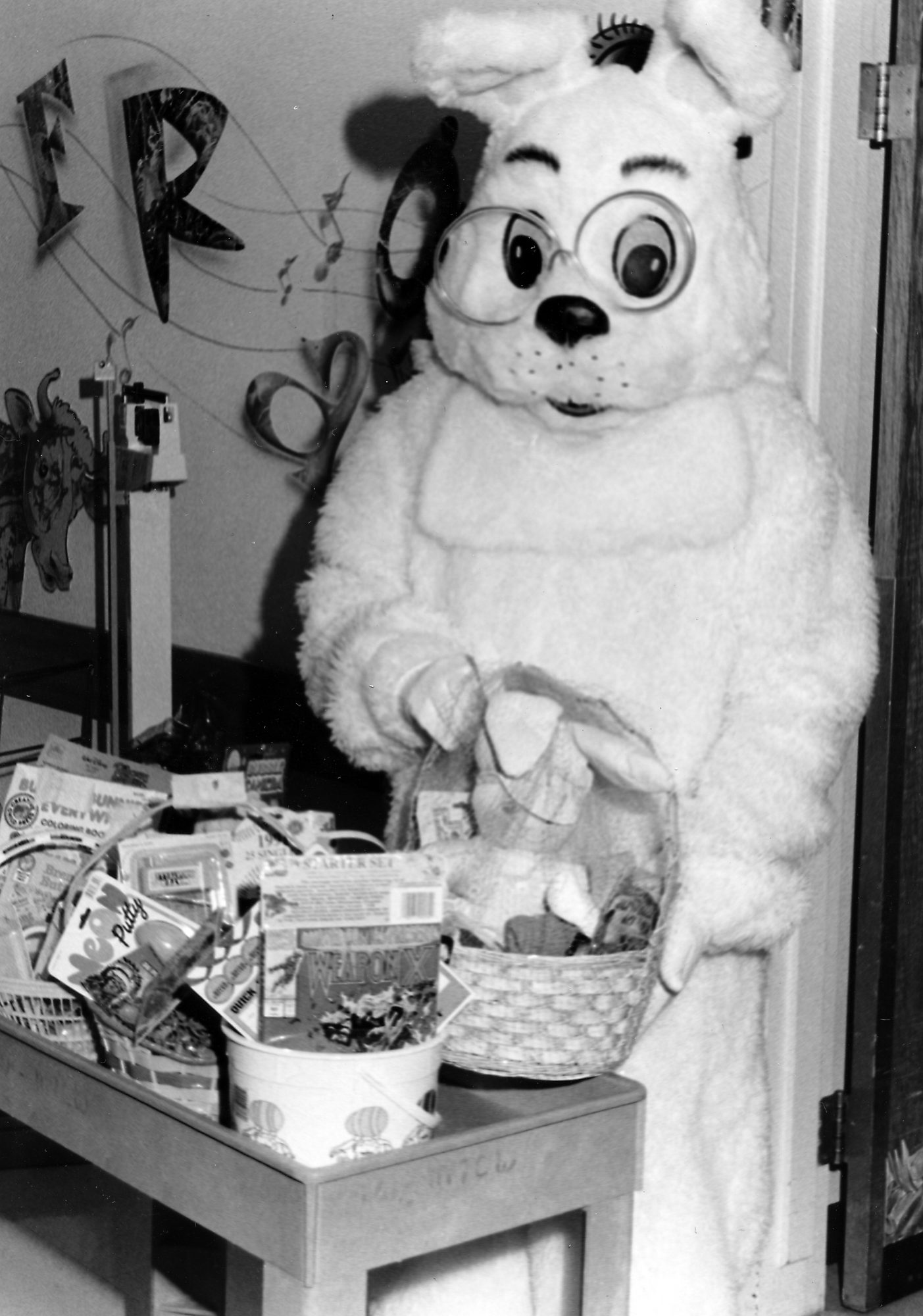 person in easter bunny costume black and white image