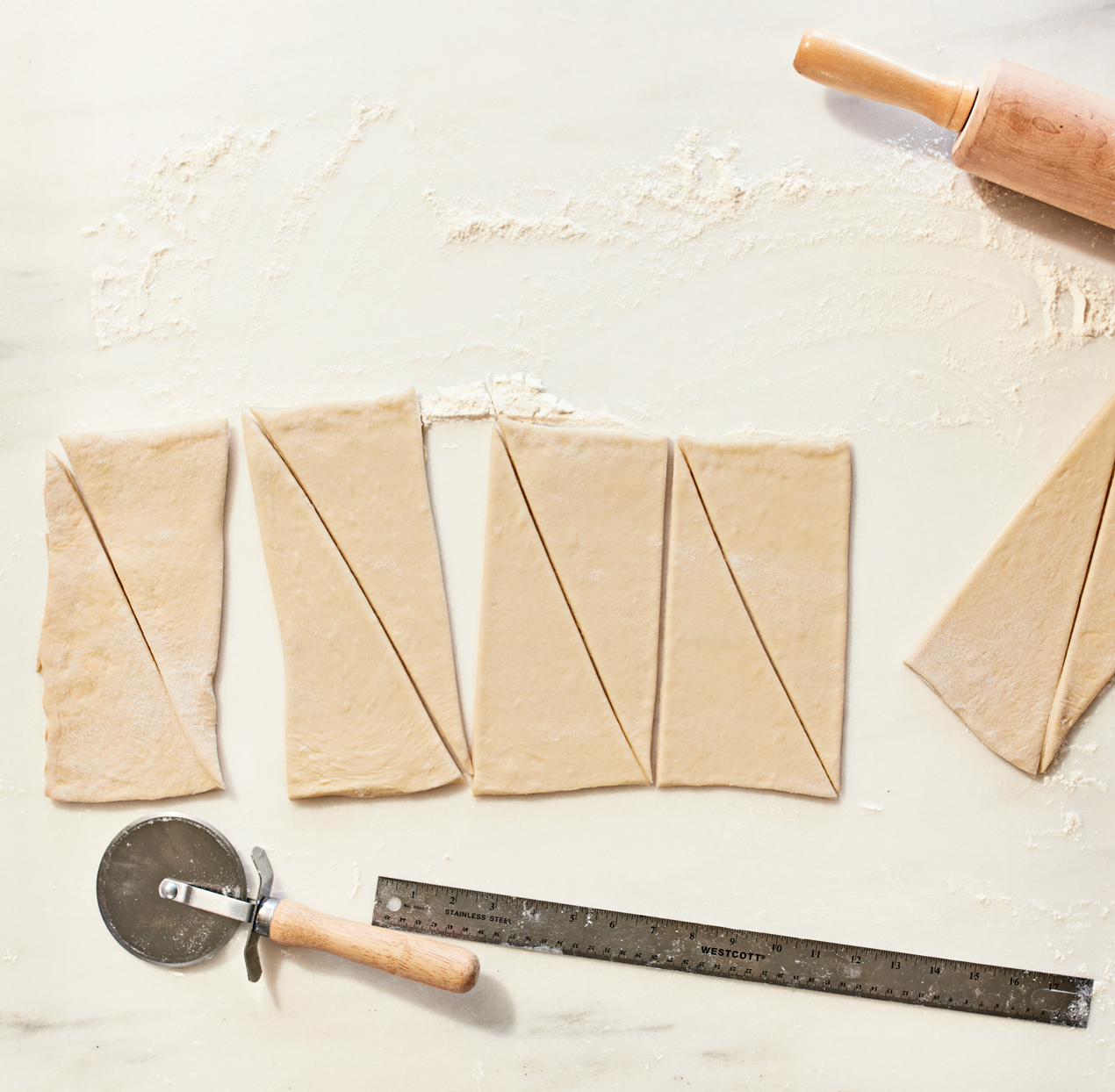 making triangles from croissant dough