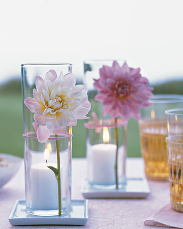 flowers in vases on table outdoors