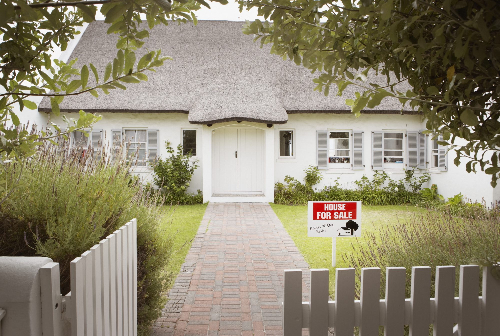 house for sale with white picket fence