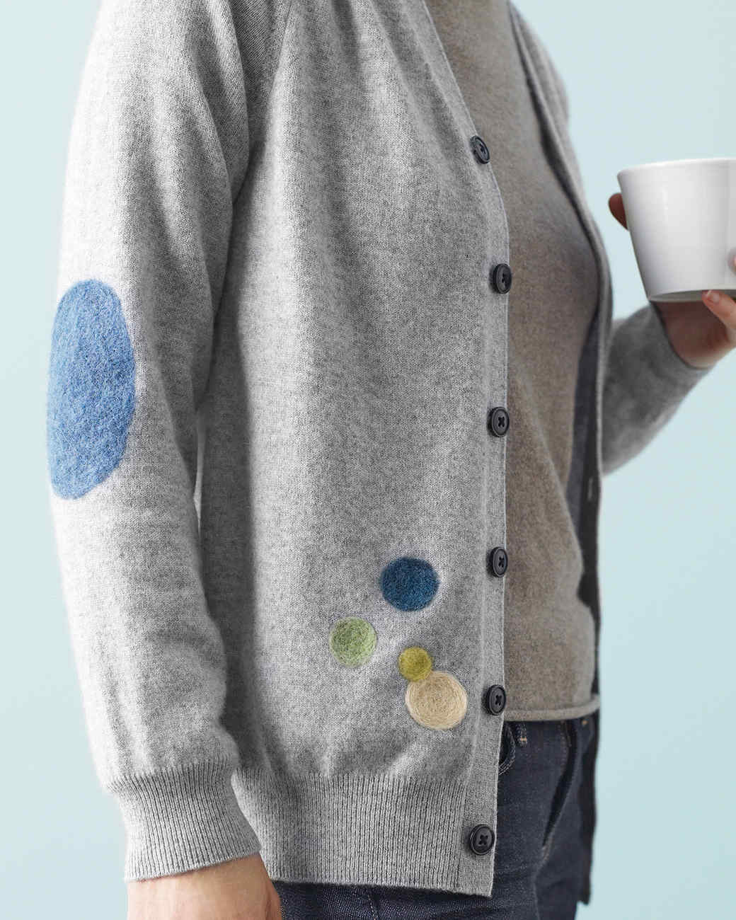 gray sweater with colorful patches