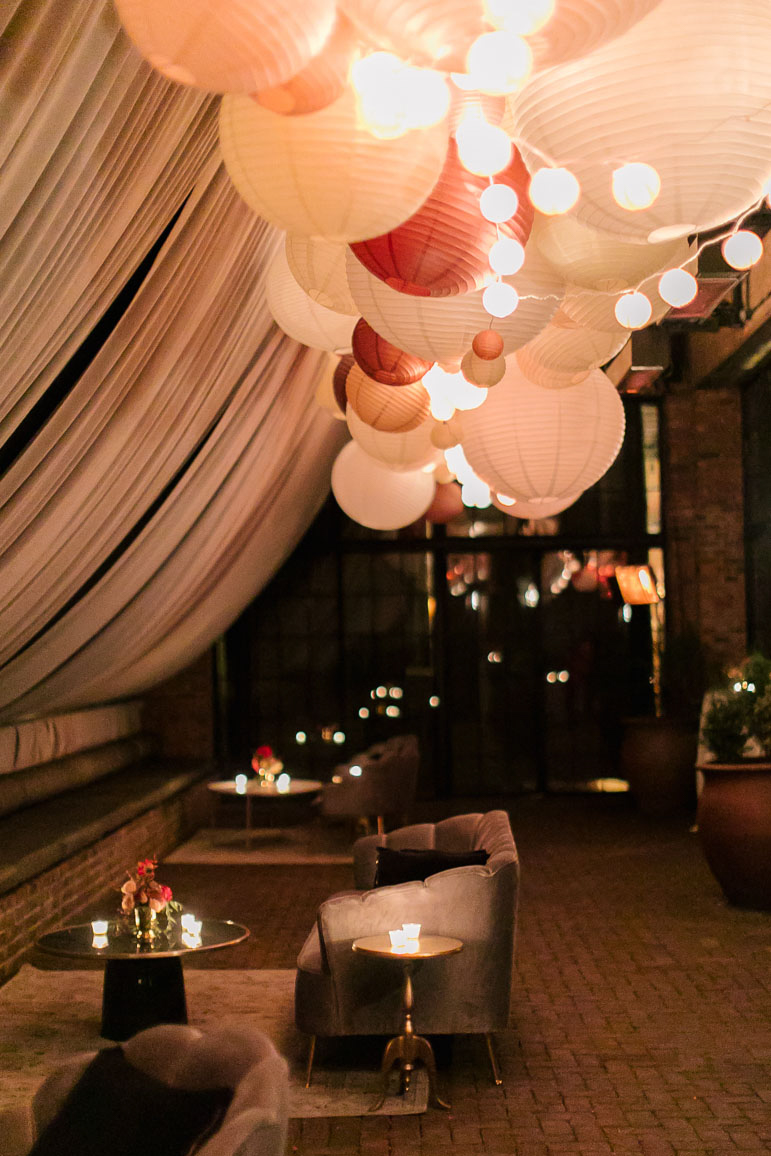 candle lit wedding lounge with hanging lanterns
