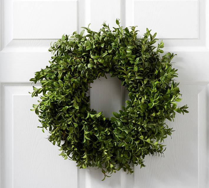 fresh boxwood wreath on white door