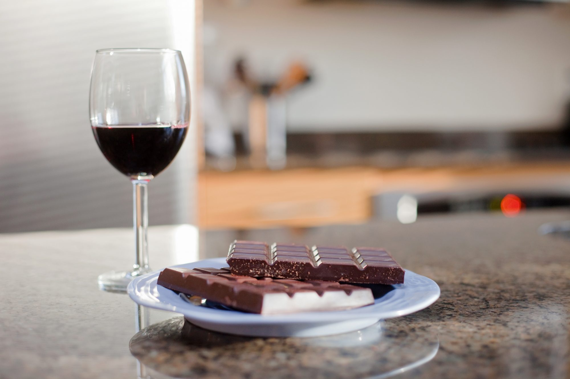 glass of red wine and plate of dark chocolate