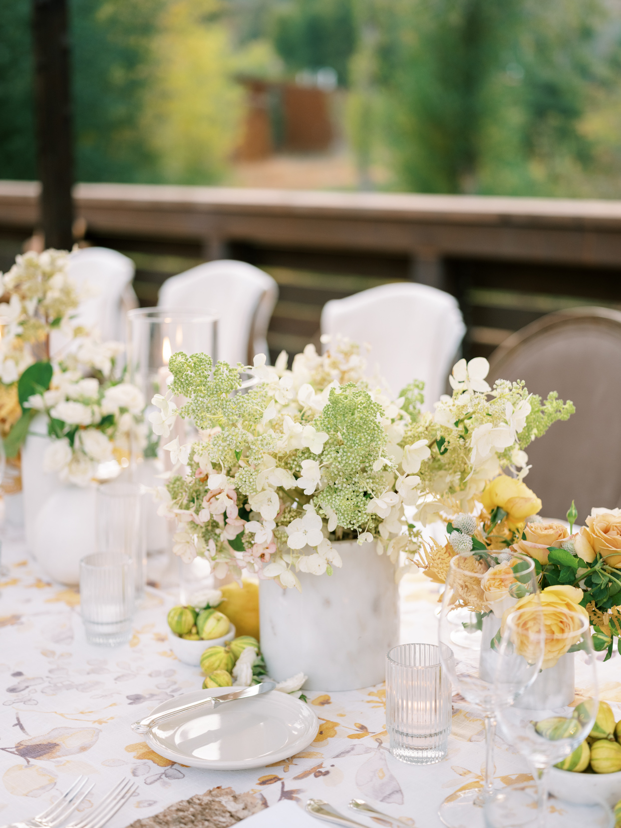 earth toned floral rehearsal dinner table detail