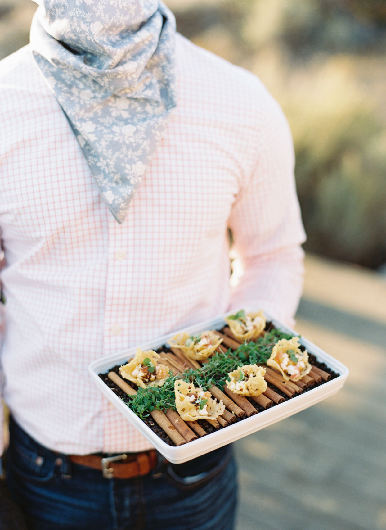 person holding cocktail hour appetizer tray