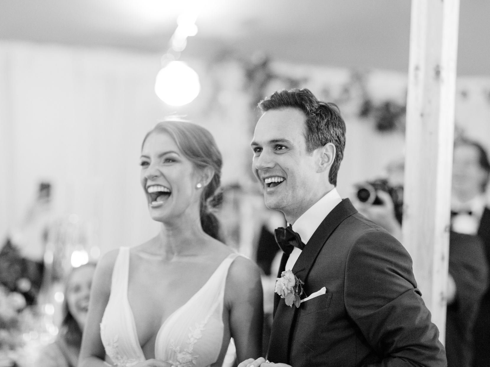 bride and groom smiling during wedding reception
