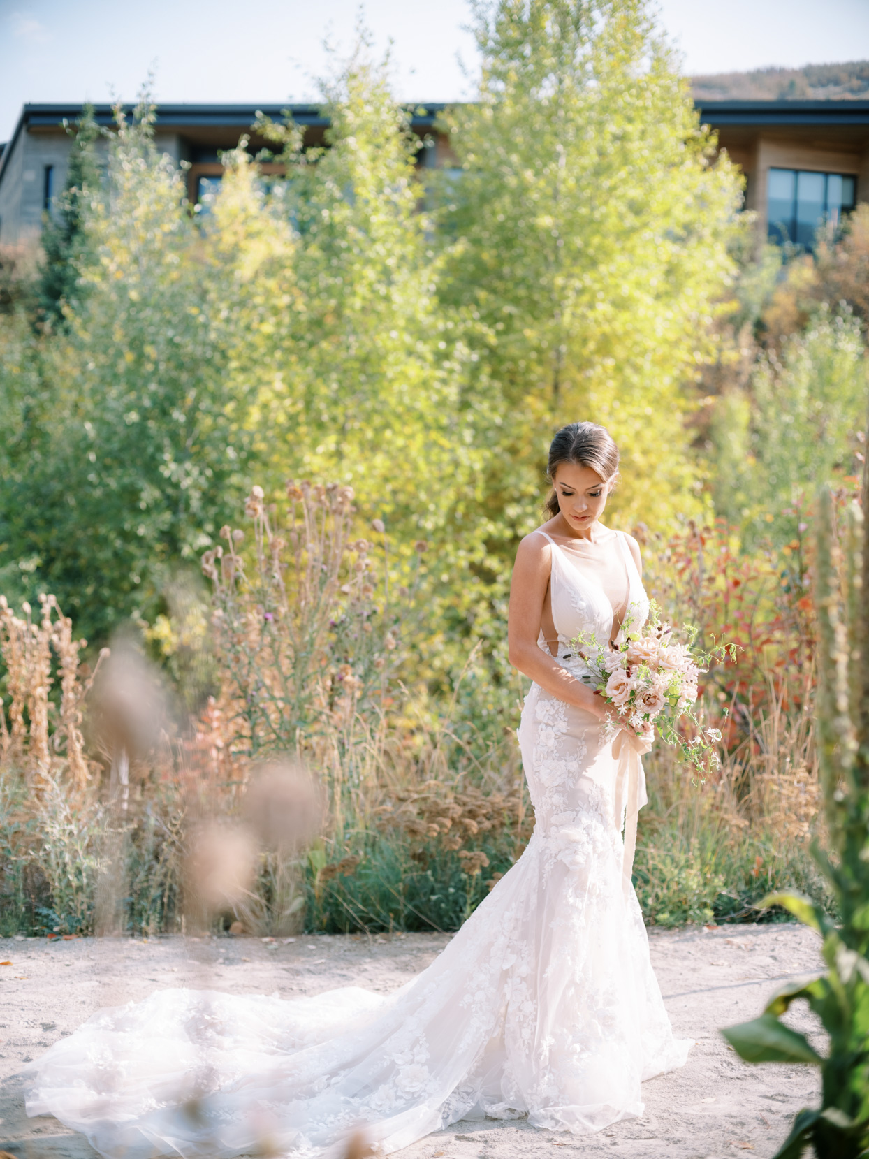 bride wearing plunging v-neck wedding dress with long train