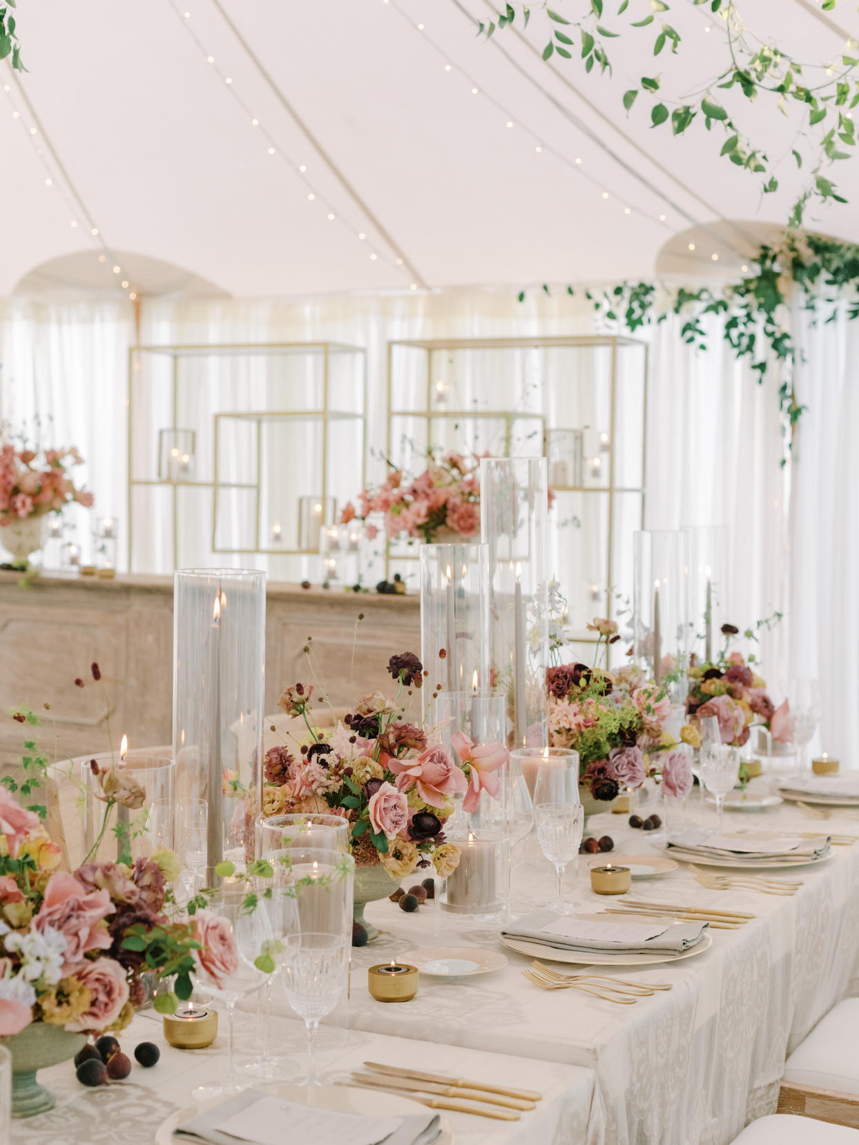 blush toned floral centerpieces with tapper candles