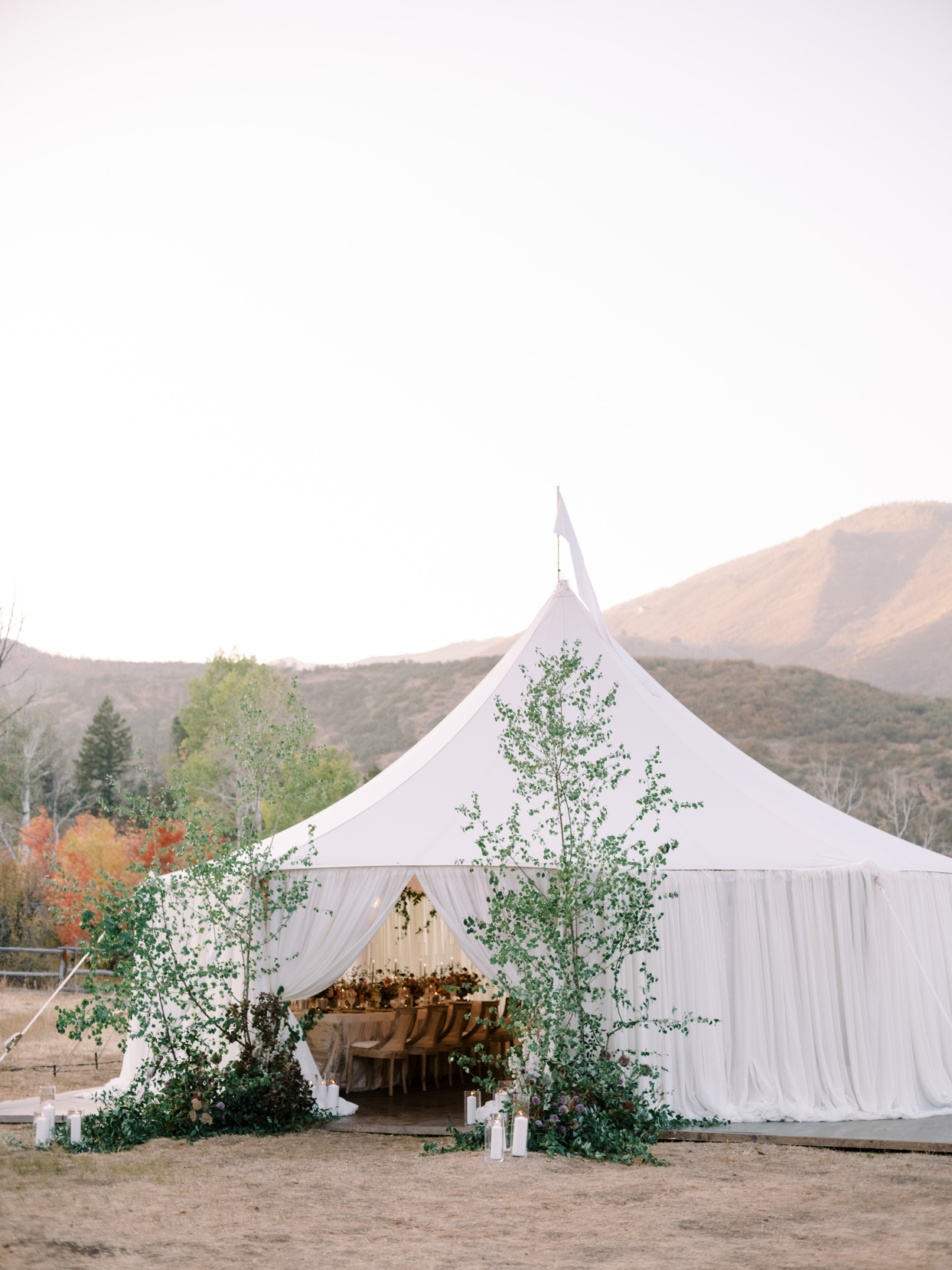 large outdoor white wedding reception tent