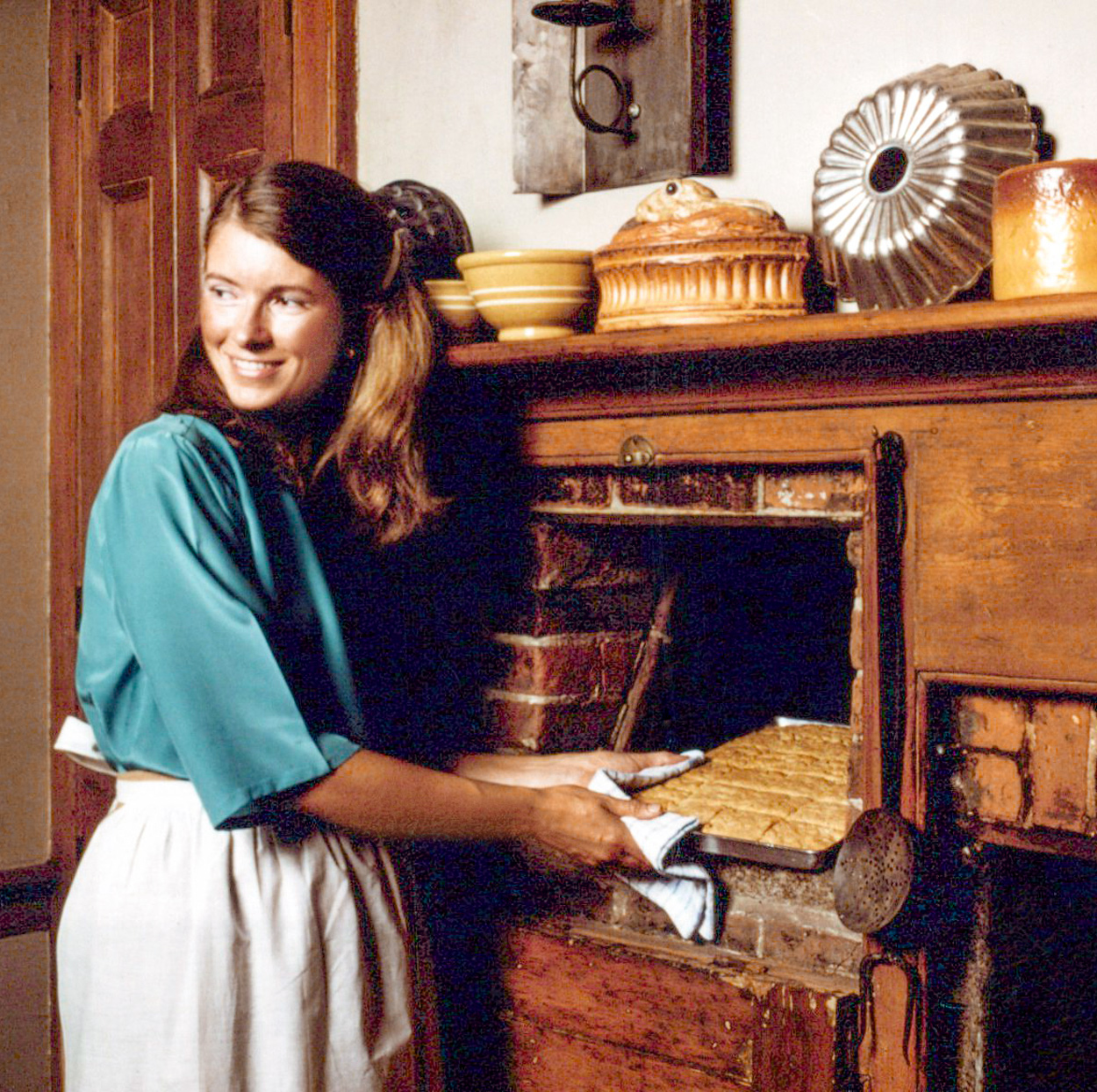 Martha at baking in beehive oven
