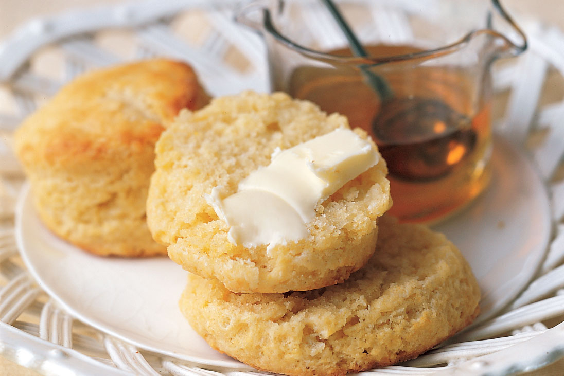 cornmeal biscuits on plate with honey
