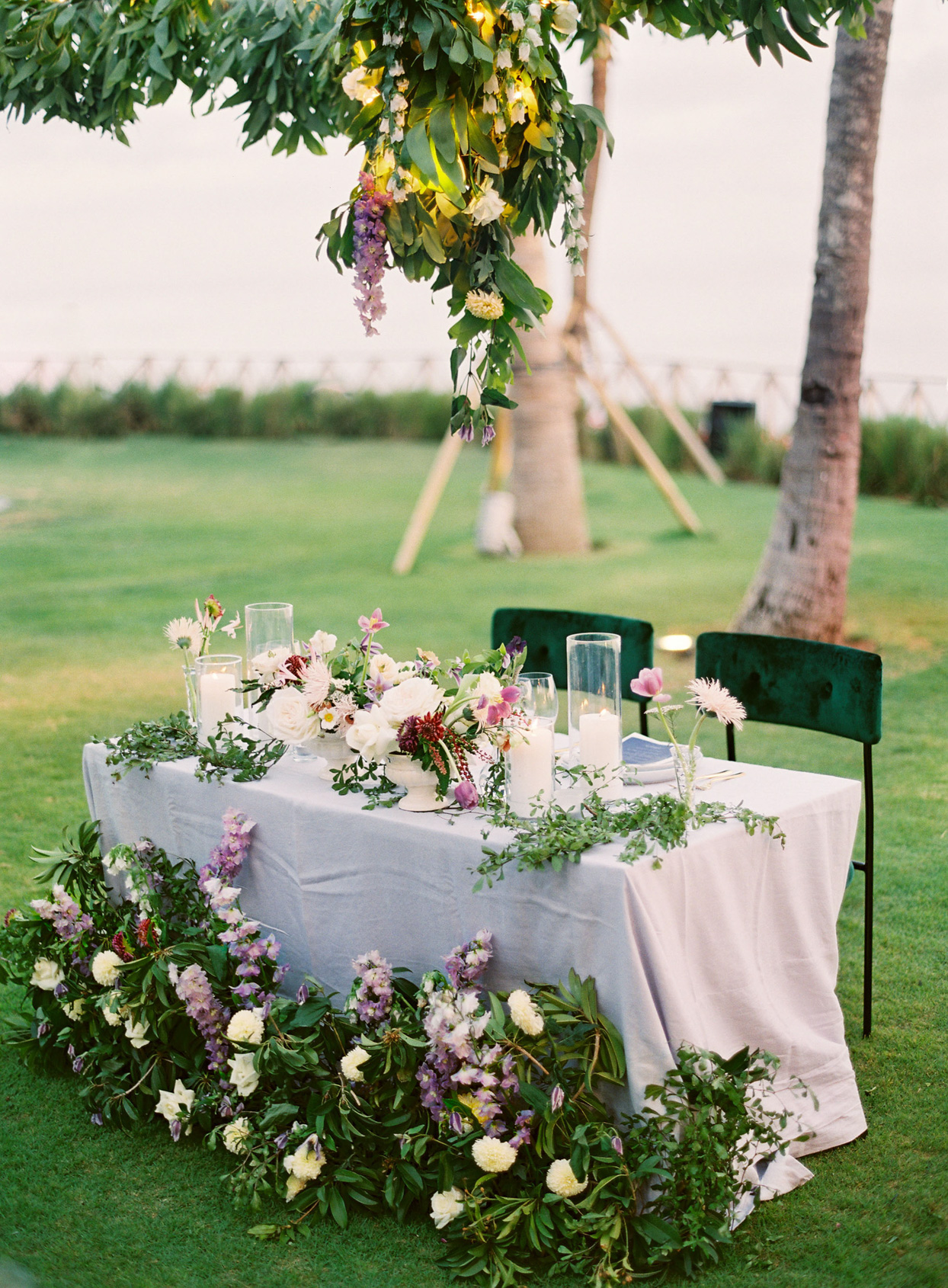 bride and groom wedding reception table with virbrant floral detail