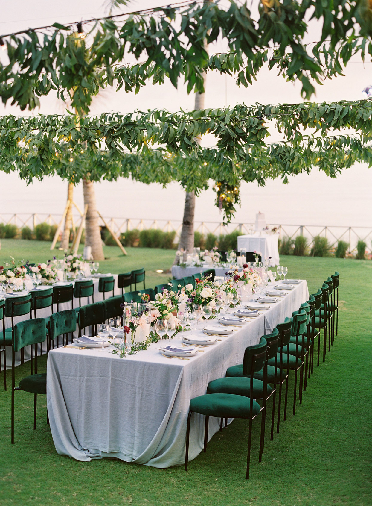 long linen covered outdoor wedding reception tables
