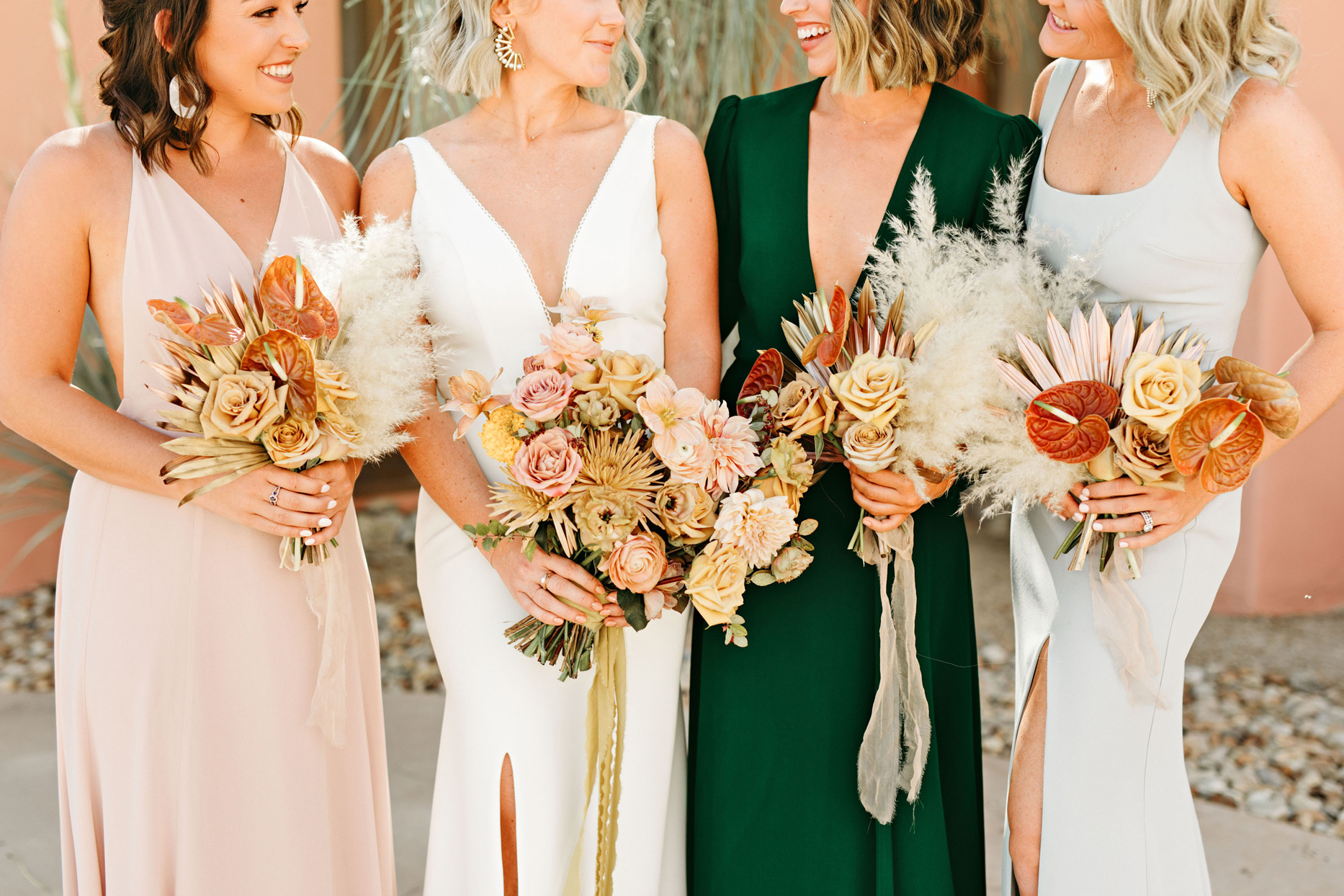 bride and bridal party holding gold and rose bouquets