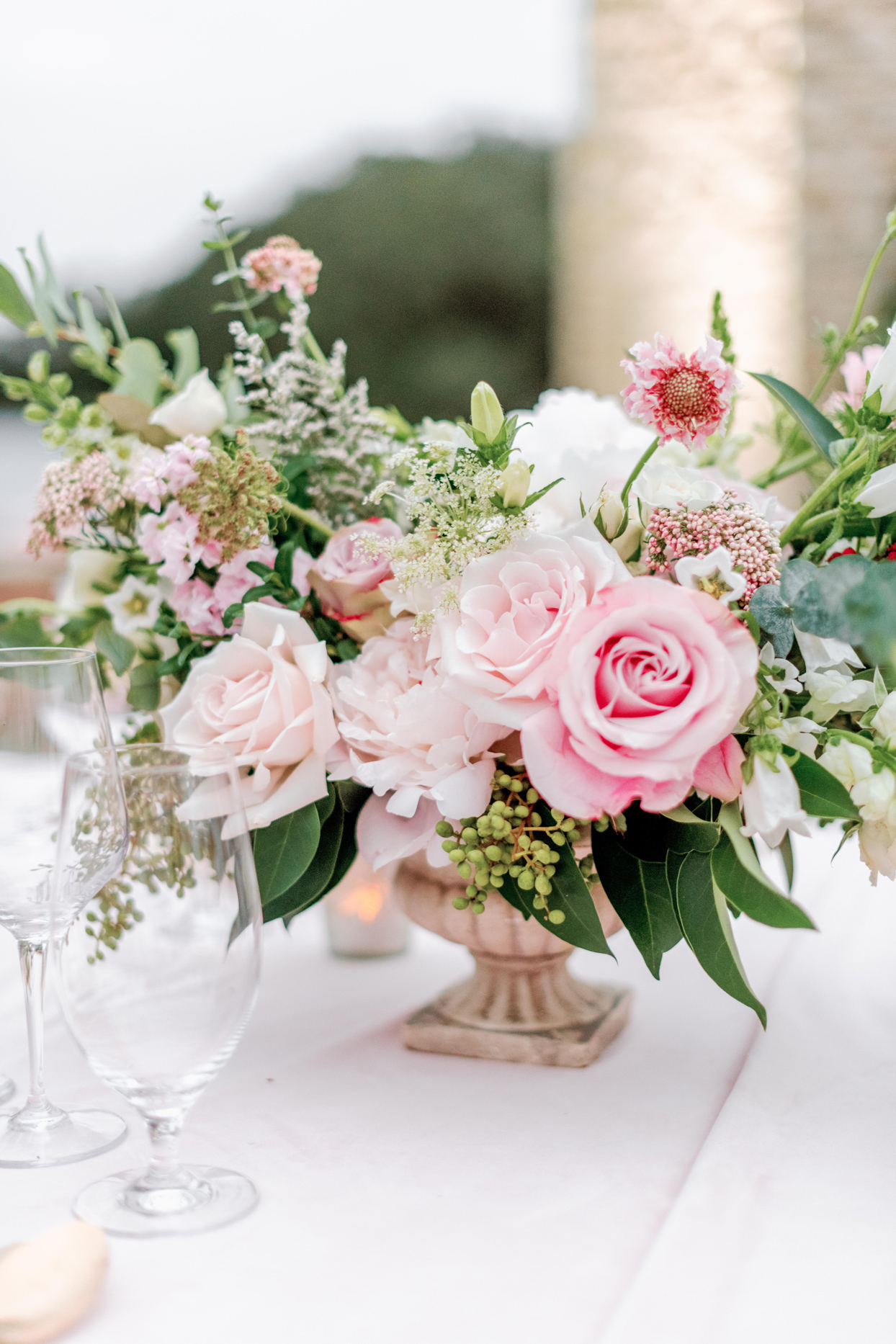 pink and white floral arrangement on table
