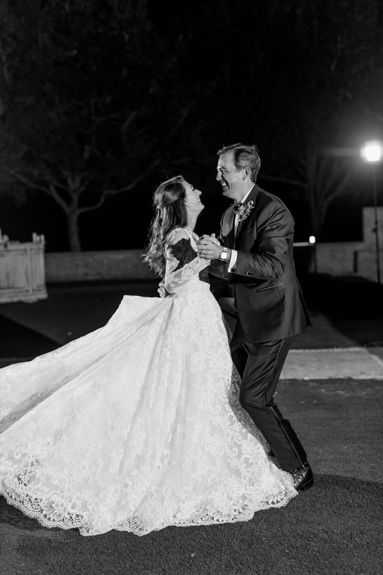 bride and groom first dance on the grass
