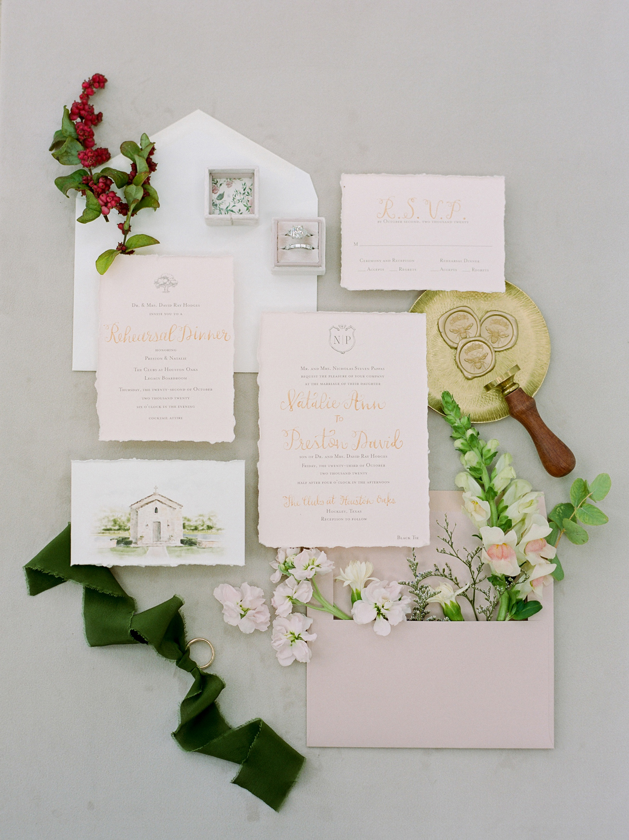 wedding invitation suite with rings and floral accents