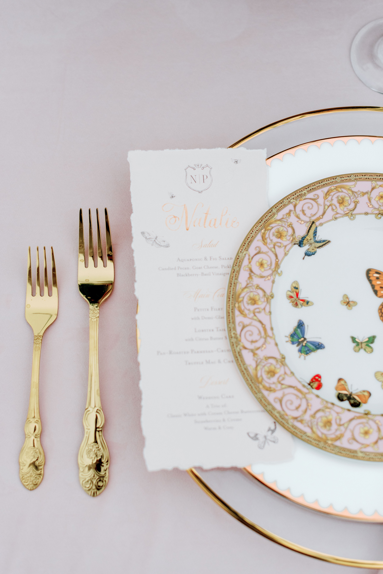 china table setting with gold accents and silverware