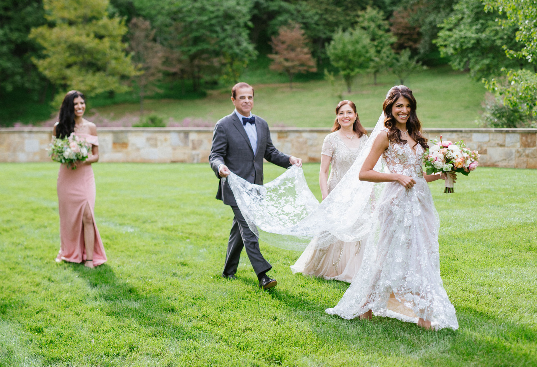 bride with family in the grass