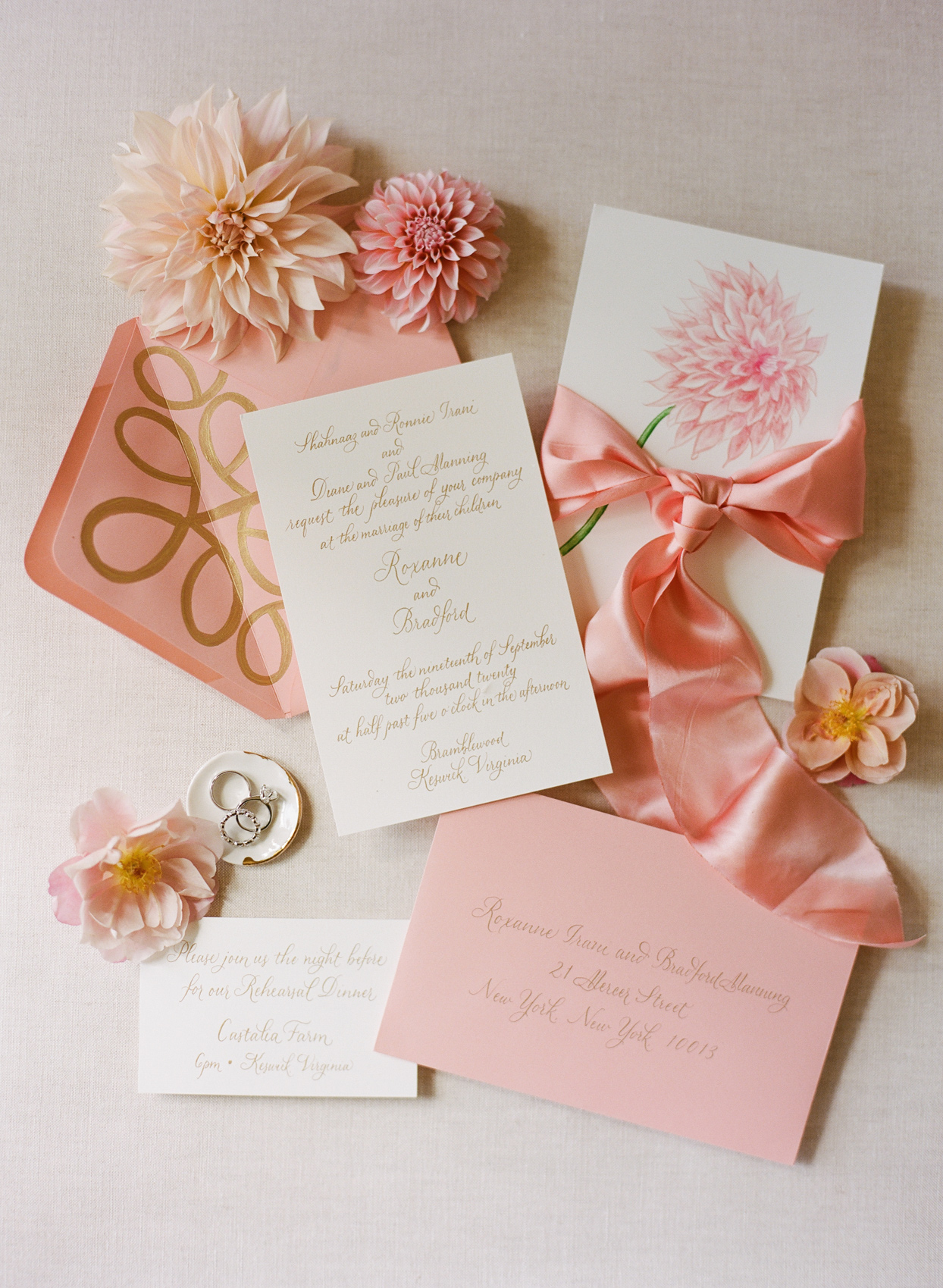 wedding suite with pink floral accents and wedding bands