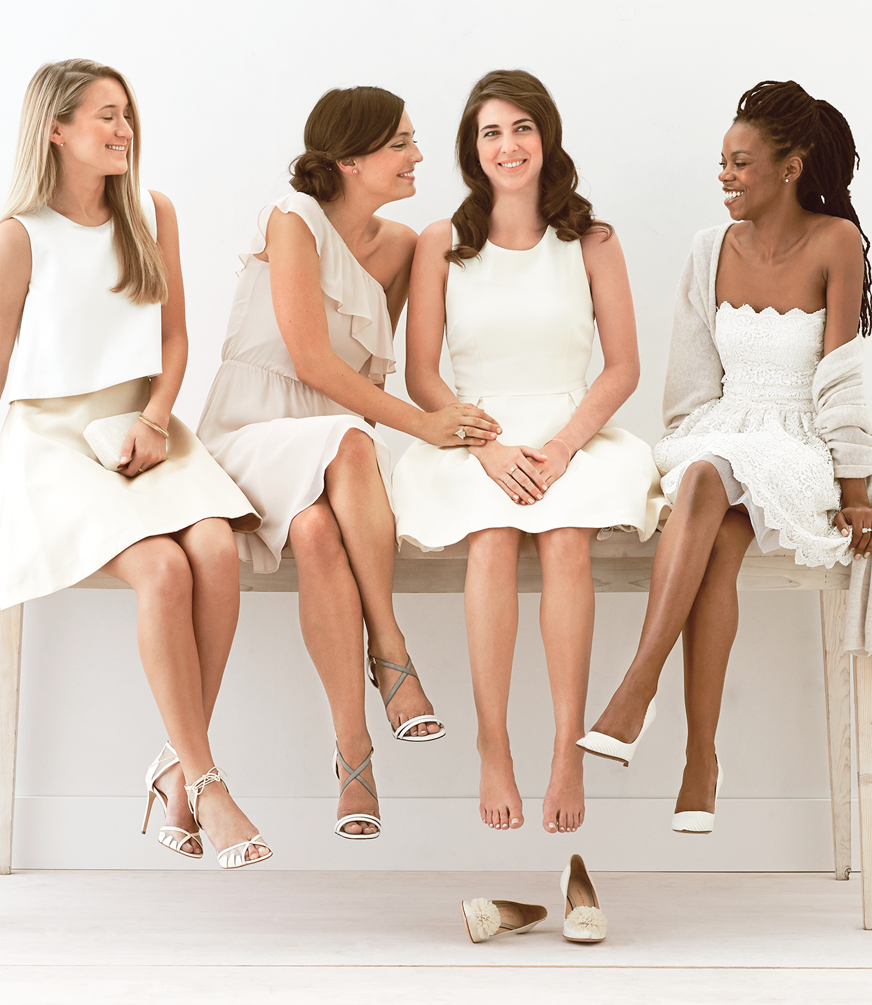 bridesmaids in white and ivory dresses