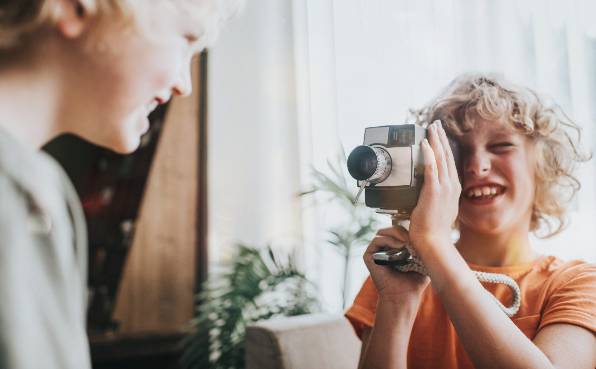 young boy with vintage video camera