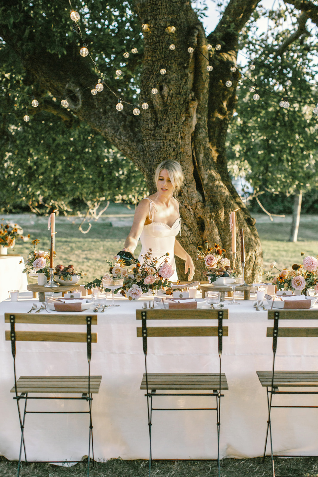 outdoor reception tables set with greenery ad candles