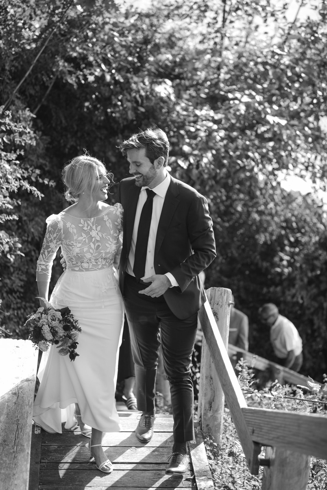 bride and groom exiting down the wooden stairs outside