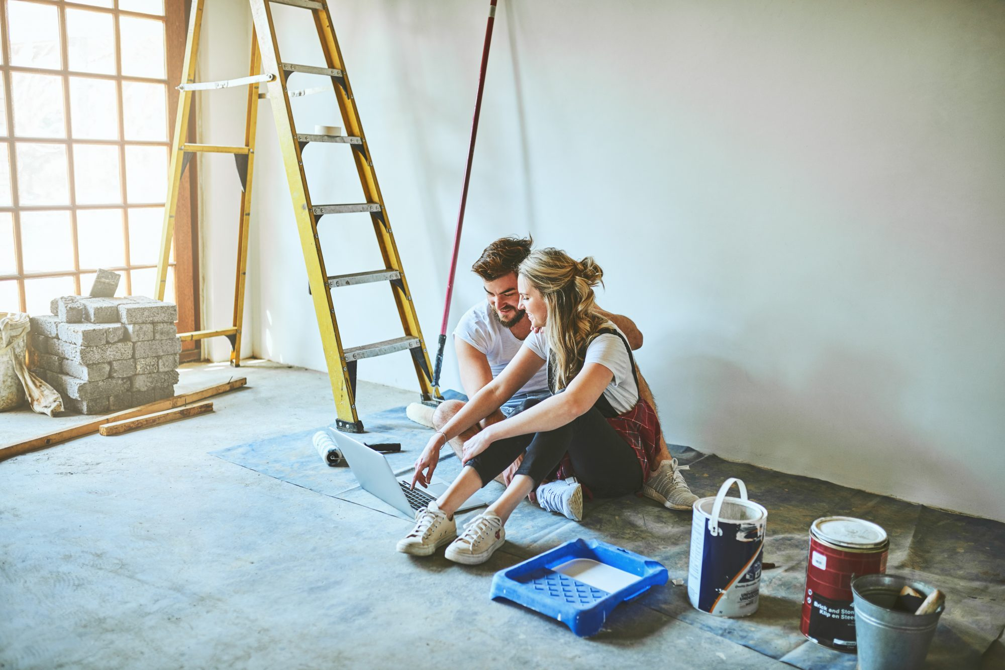 couple looking at laptop home renovation