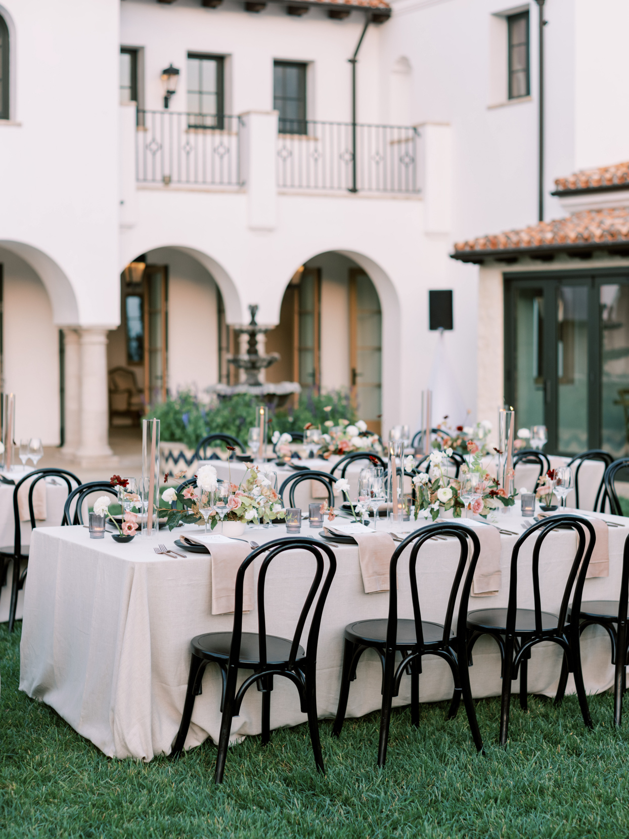outdoor elegant wedding reception tables with fall florals