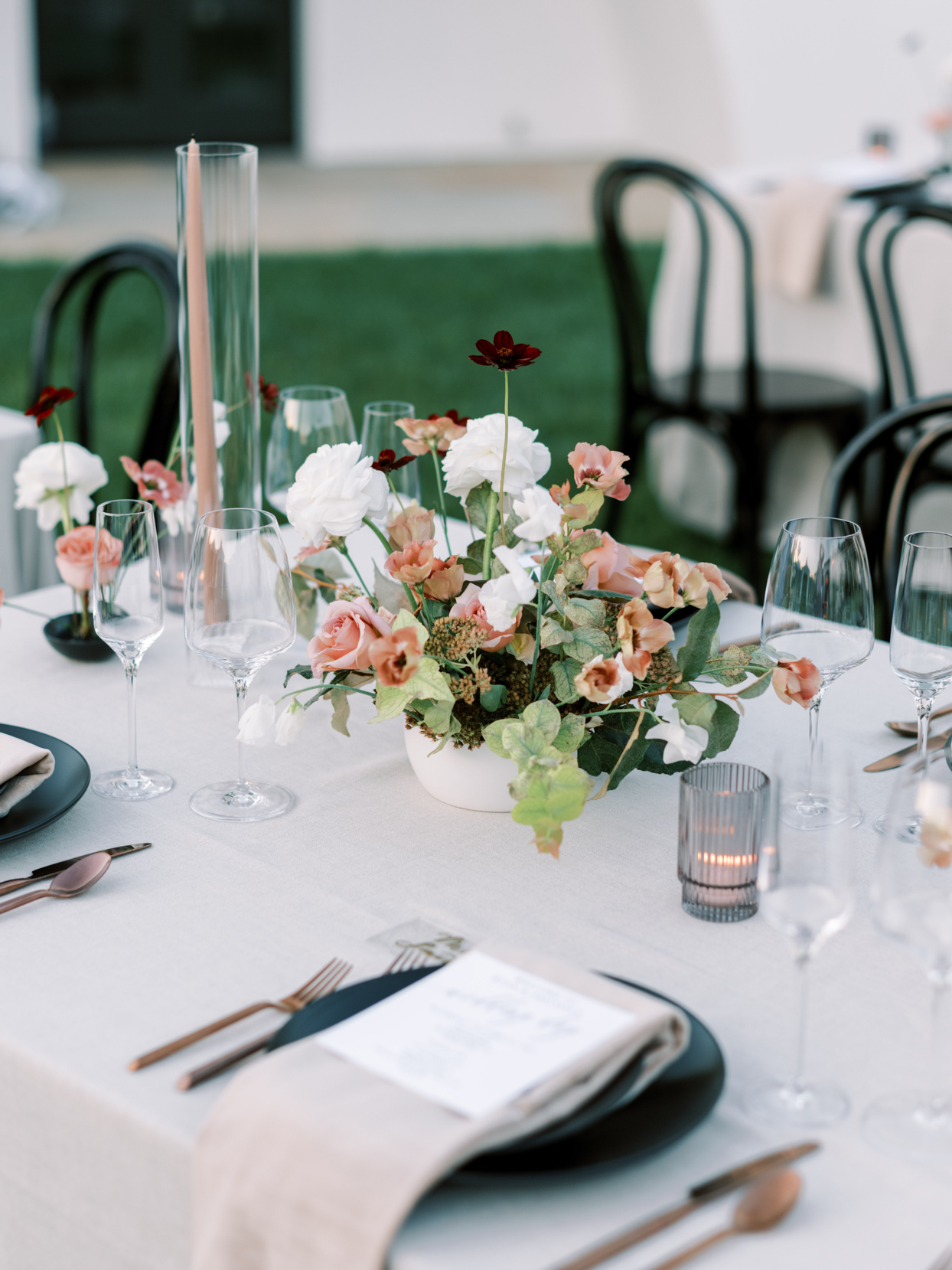low fall floral bouquet on reception table
