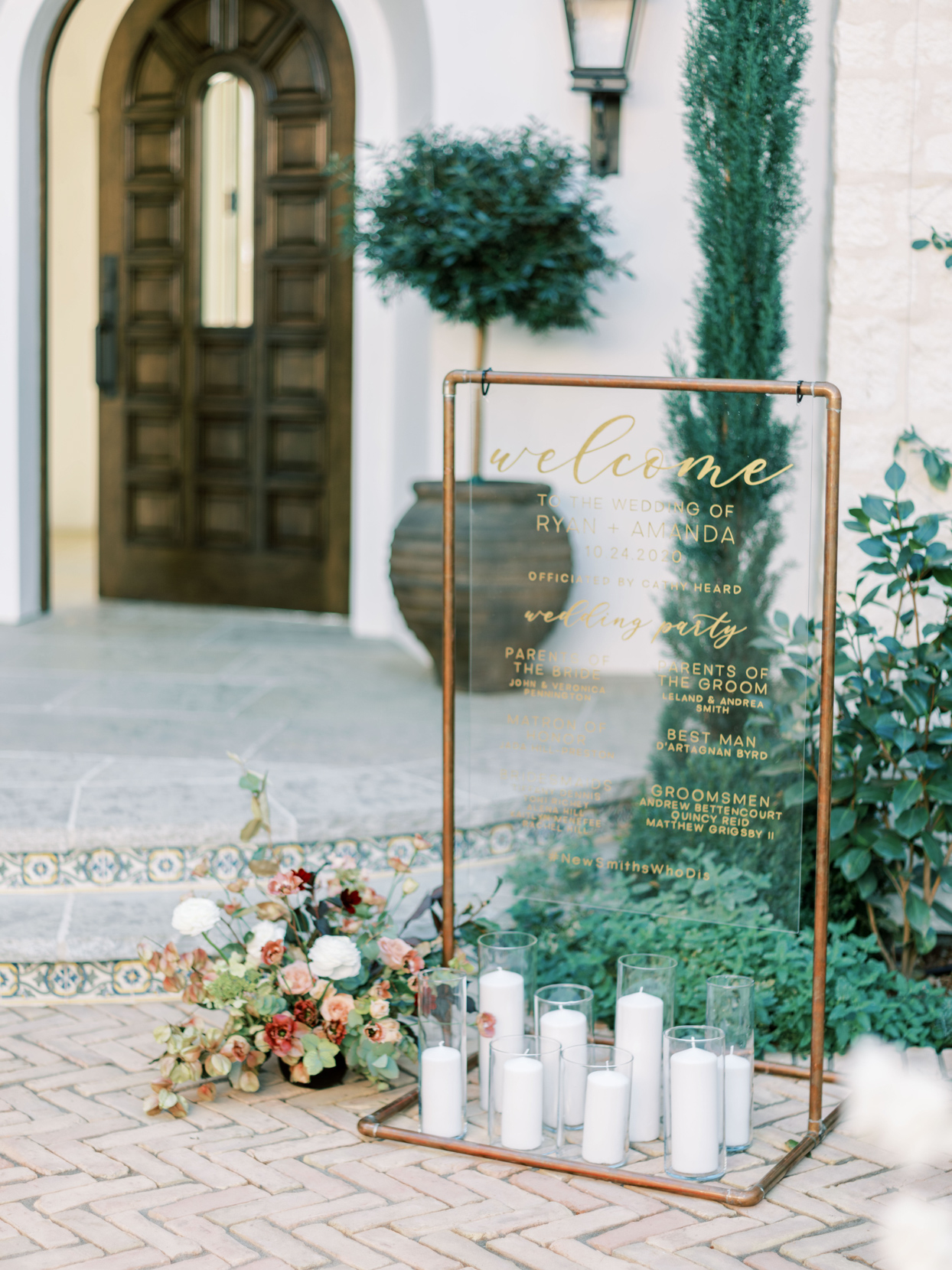gold framed lucite wedding sign with candles below