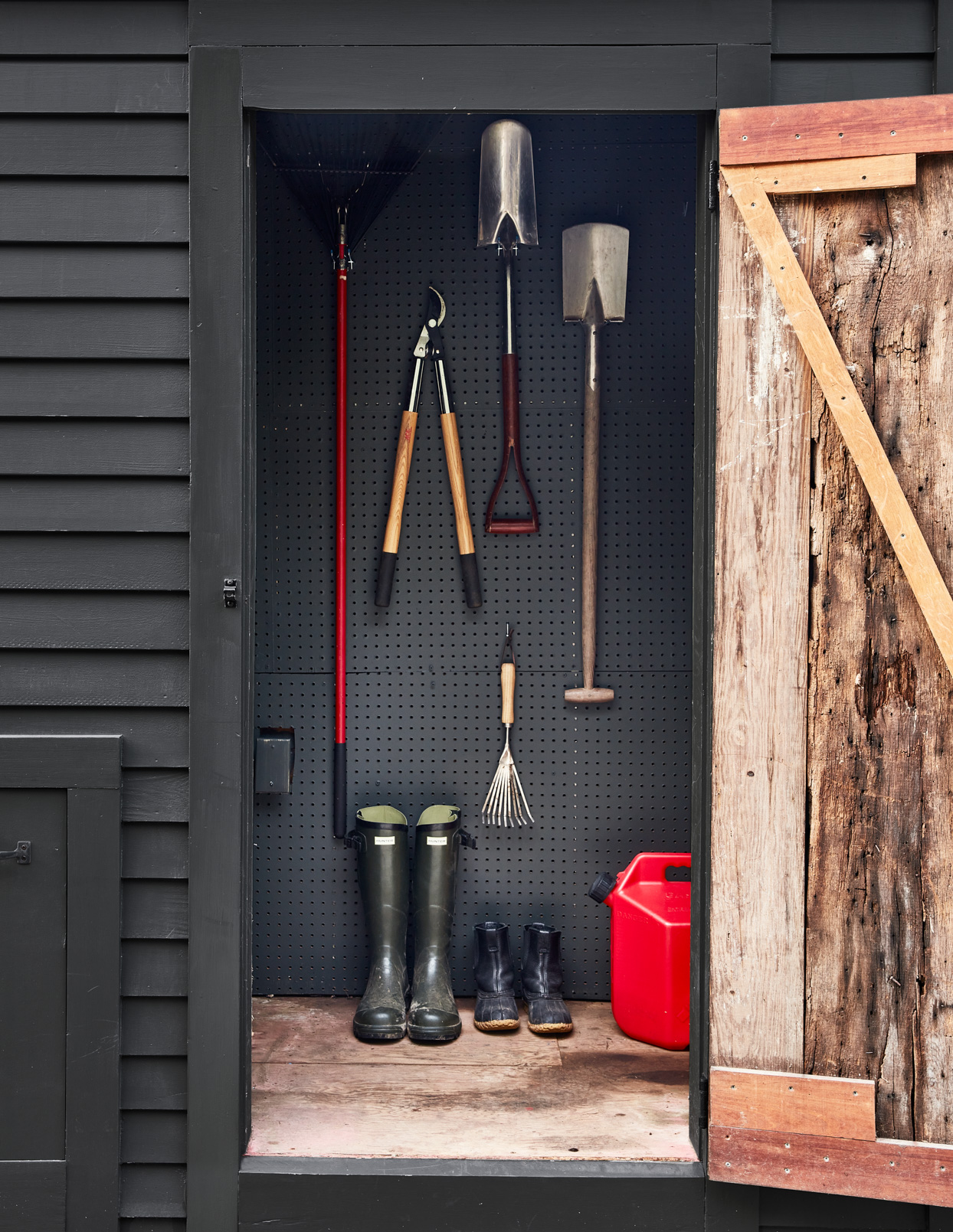 tools hanging and boots inside shed