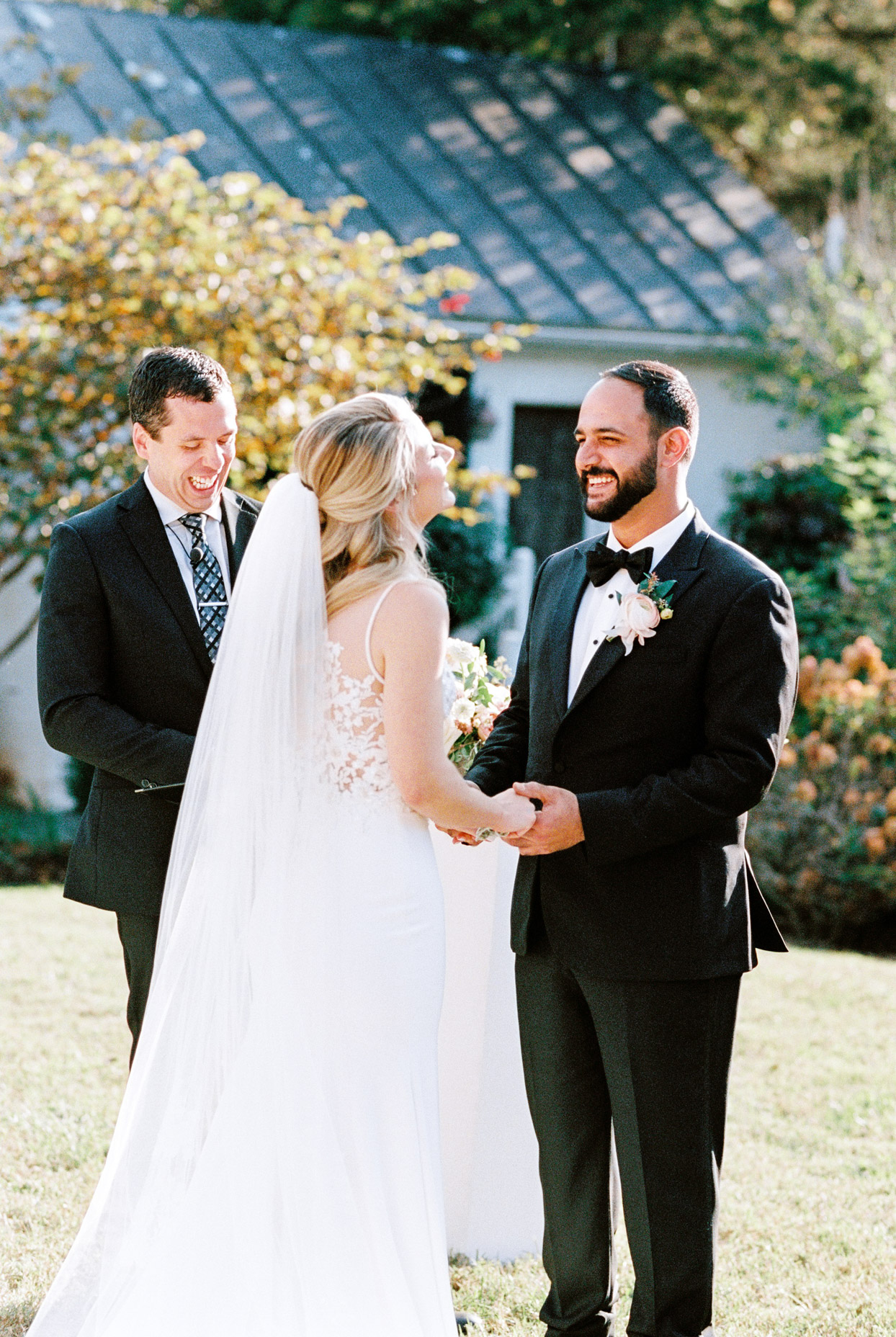 couple smiling at each other during ceremony