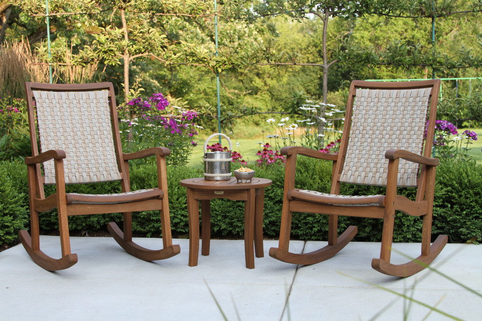 outdoor interiors 3 piece rocking set with table on patio