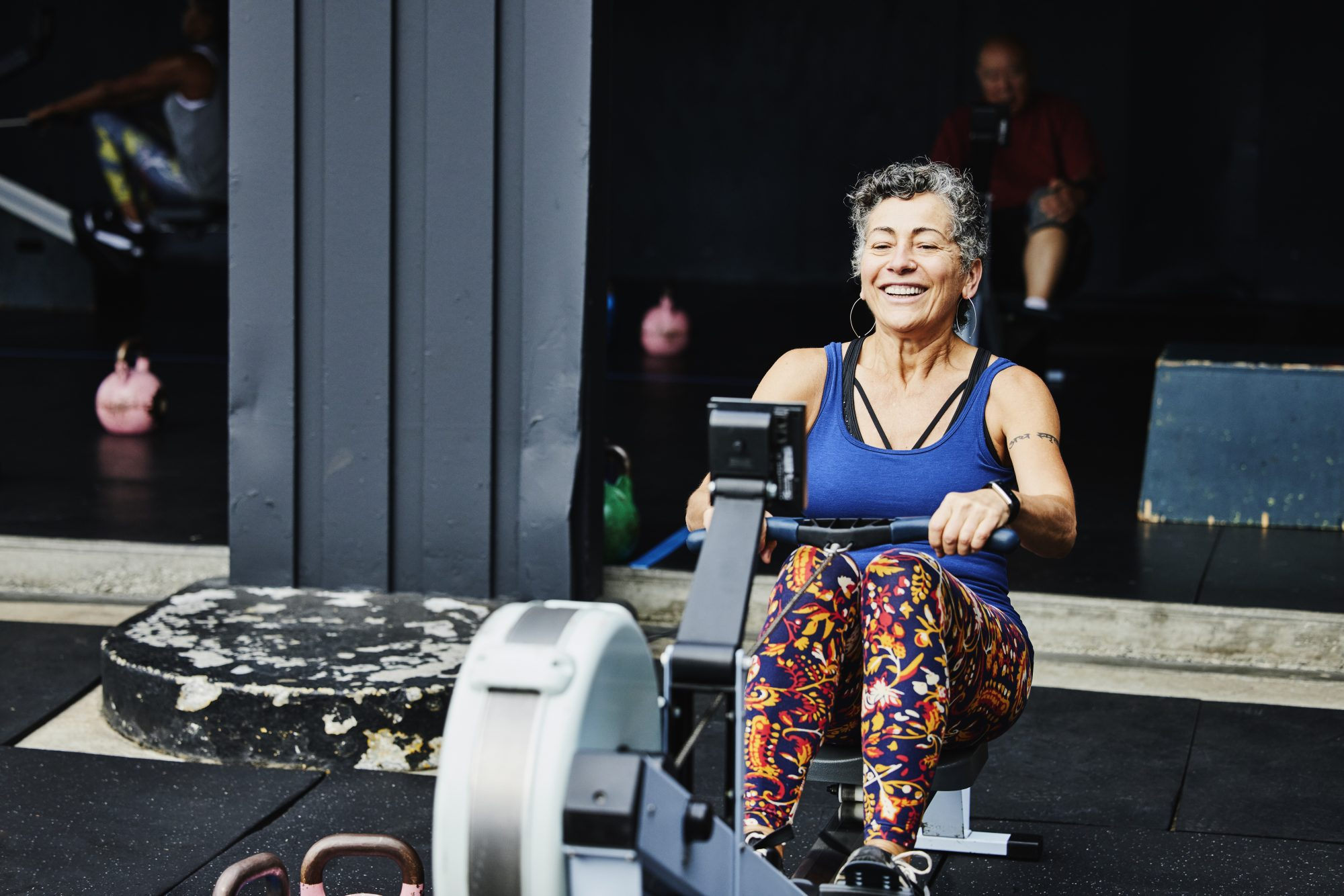 mature woman exercising on rowing machine outdoors