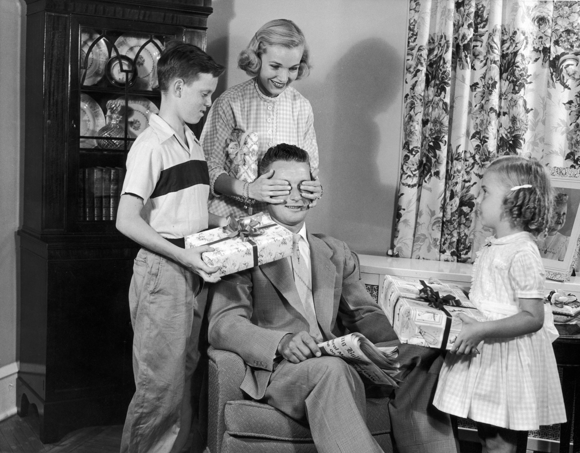 historic image of father receiving gifts for father's day