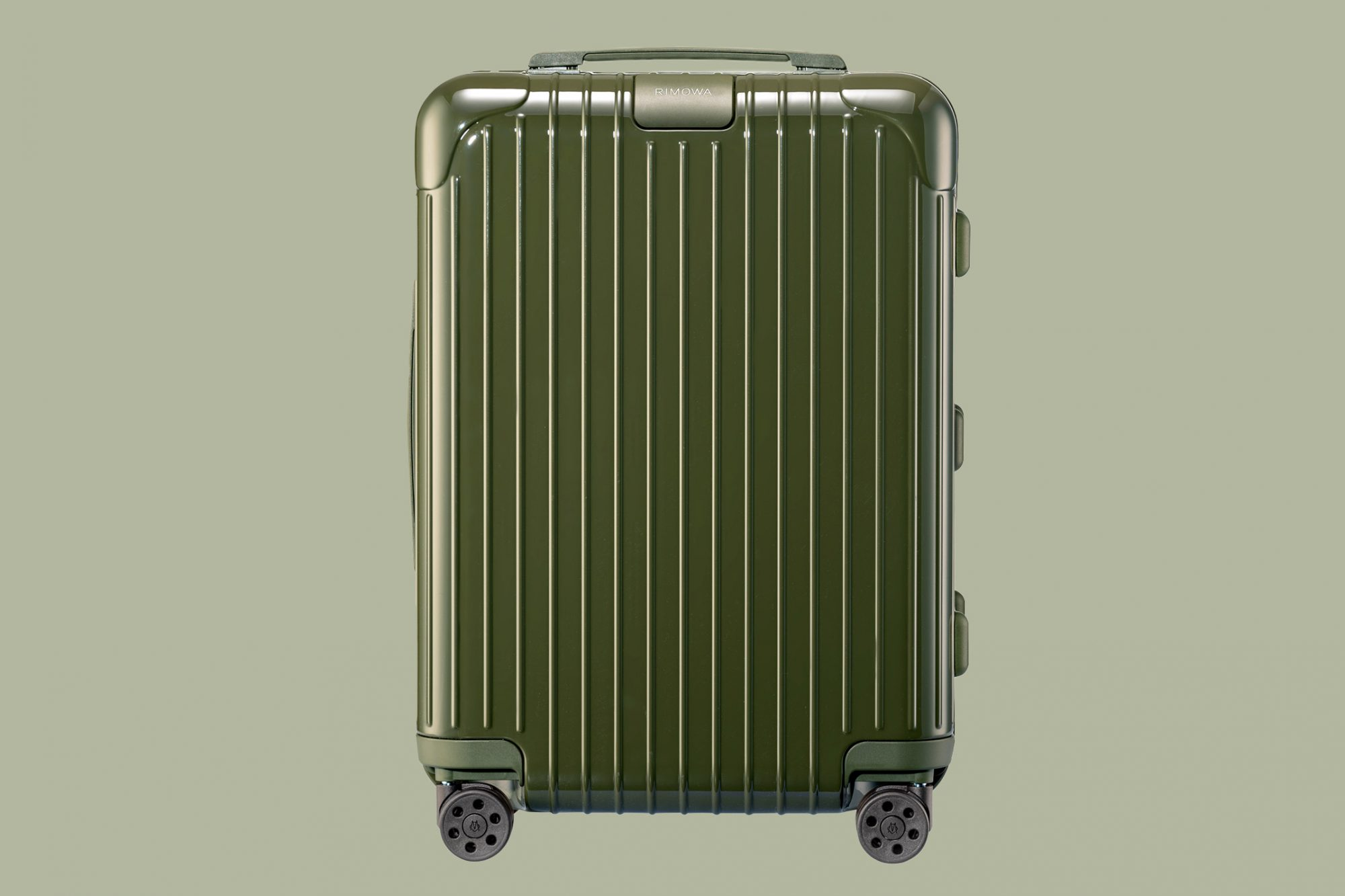 green rimowa cabin carry on suitcase