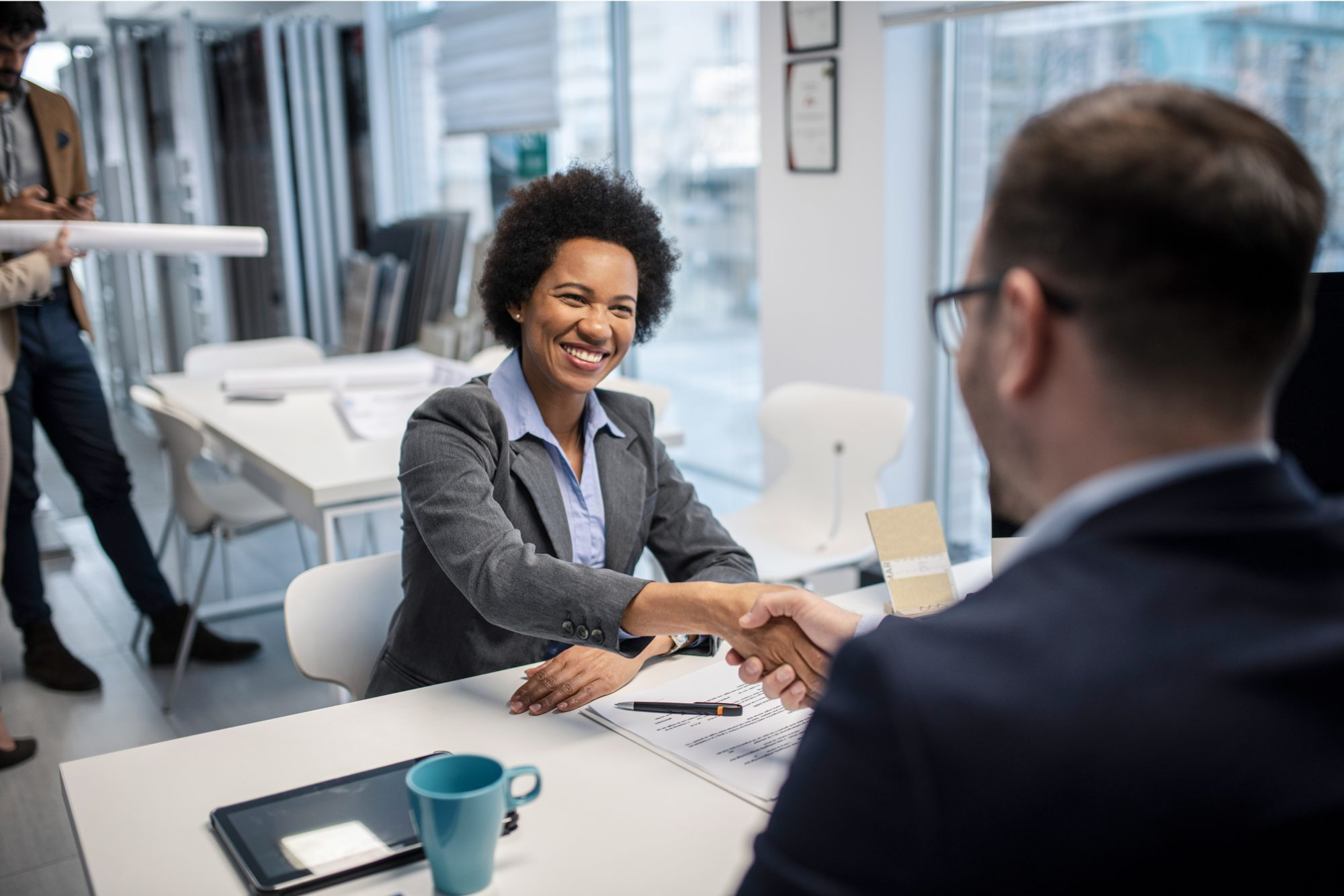 woman shaking hands with new employer