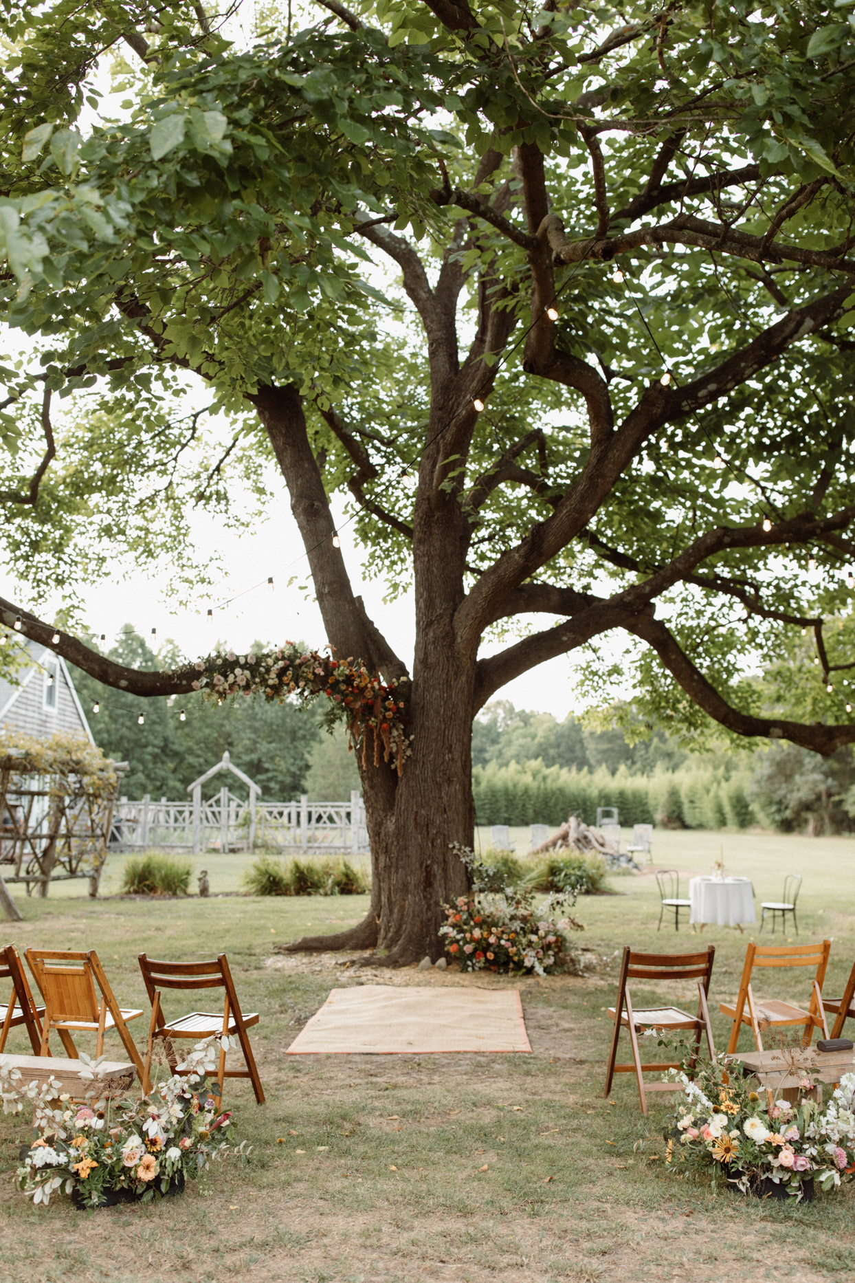 large backyard tree ceremony set up space