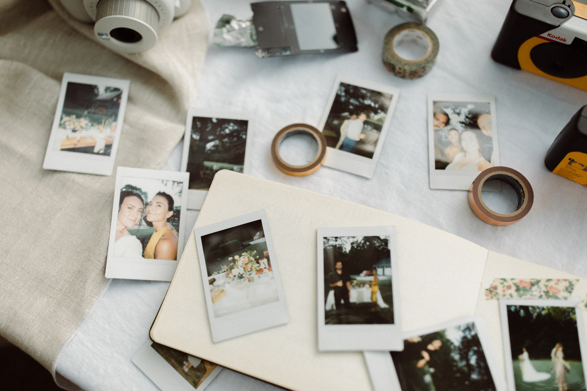 various polaroid photos laid out on table