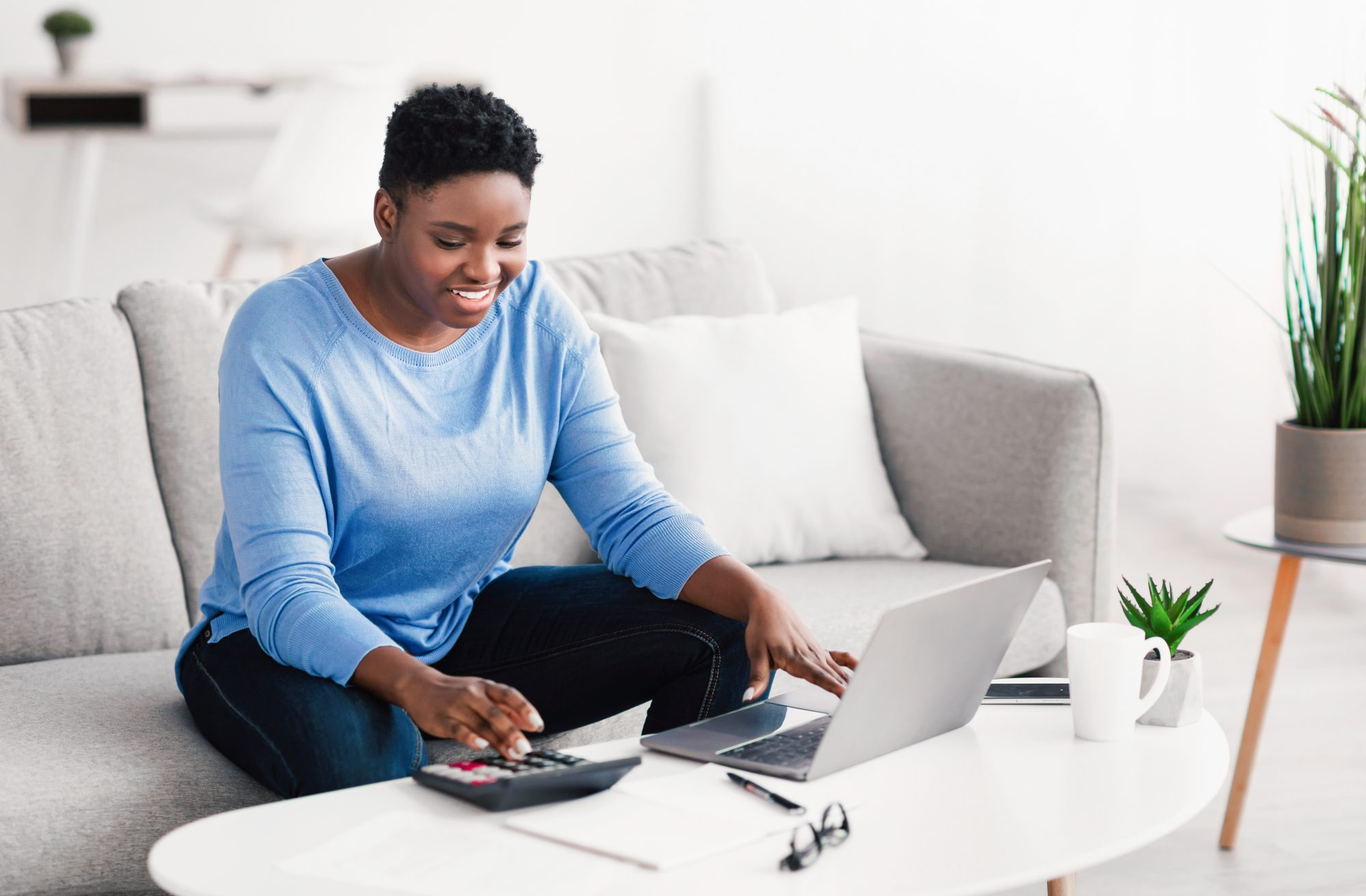 woman applying for loan from couch