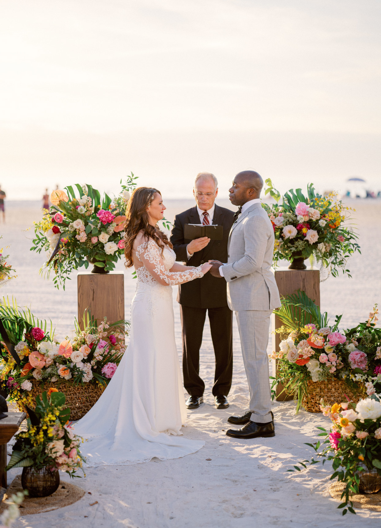 bride and groom during ceremony on beach