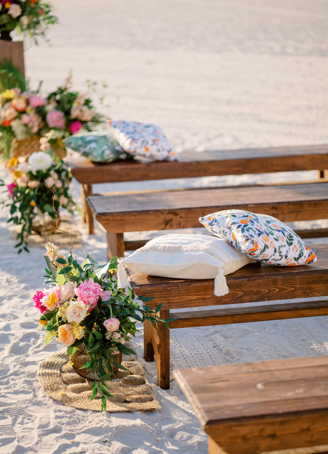 pillows on wooden benches for wedding ceremony